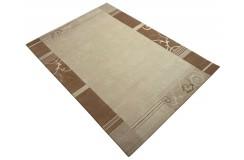 Welniany ręcznie tkany dywan Nepal Premium beżowy 120x180cm