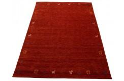 Gładki 100% wełniany dywan Gabbeh Loribaft ceglasty 170x240cm delikatne motywy zwierzęce