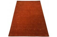 Gładki 100% wełniany dywan Gabbeh Loribaft  pomarańczowy 180x270cm delikatne motywy orietnalne