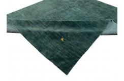 Gładki 100% wełniany dywan Gabbeh Loribaft zielono-szary 250x350cm delikatne motywy zwierzęce