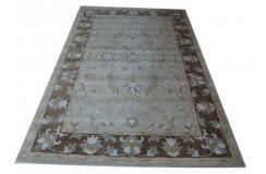 Jasnozielony dywan z brazowym obramowaniem Ziegler Persian 155x245cm wełna owcza