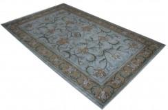 Jasno niebieski dywan z brązową bordiurą główną 100% wełna Indie